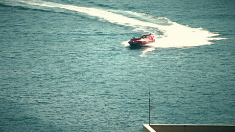 BUDVA, MONTENEGRO - JULY 26, 2018. Recreational high speed motorboat makes Footage