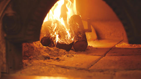 Burning firewood and pizza in wood-fired oven. Traditional italian cuisine Live Action