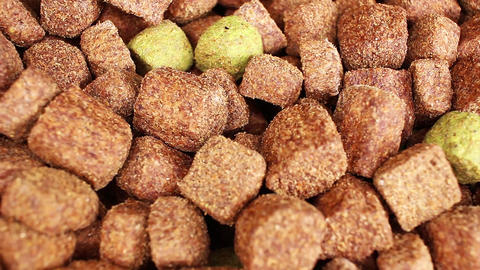 Dog food dry grains pet foods looping texture pattern closeup video Live Action