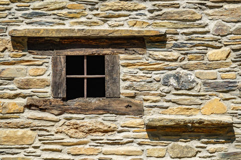 Stone facade with wooden window frame, front view Fotografía