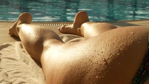 Woman's legs sunbathing on the beach lounger Footage