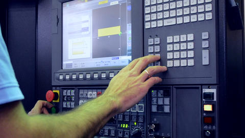 Man working on the control panel works with an industrial machine at the factory Footage