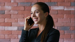 Businesswoman with ponytail having phone conversation Footage