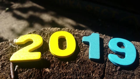New Year 2019. Christmas. Colored numbers on a Wooden background Live Action