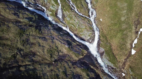 Streams at the mountain side in Norway. Aerial speed ramp shot Footage