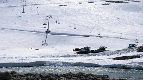 Ski lifts running at summer ski center by river in Norway Archivo