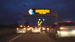 Driving on freeway in twilight, rack focus Footage
