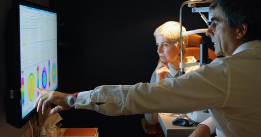 Optometrist explaining eyesight report on screen 4k Live Action