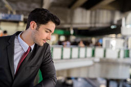 Portrait of young handsome businessman wearing suit in city Fotografía