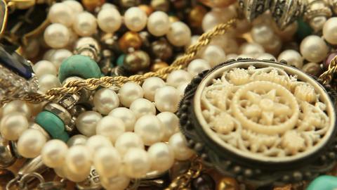 Jewelry pile turning slowly Footage