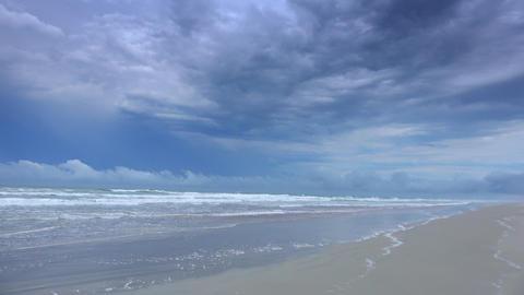 Great sky over Altlantic ocean with an empty sandy beach Live Action