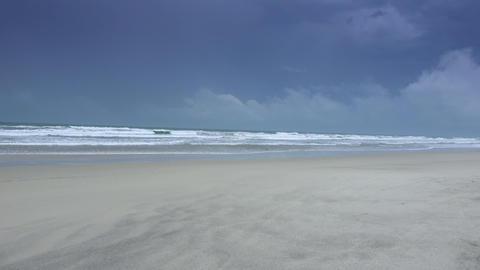 Empty sandy beach on a rainy day - Atlantic ocean Live Action