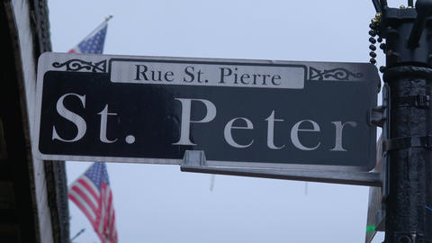 Street sign St Peter street in New Orleans French Quarter Live Action