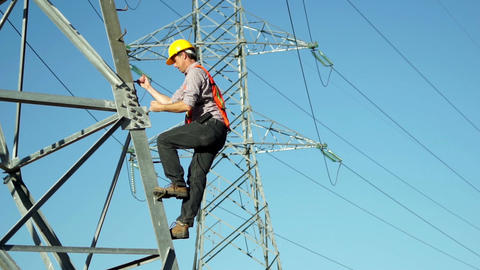 Worker Climbs Electrical High Tension Pole Footage