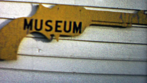 1959: Old Wild West Gun Museum free entry sign and building Footage