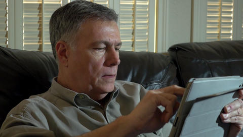 man at home using a tablet pc Live Action