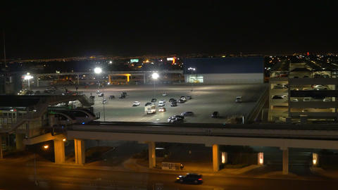 night shot of the monorail coming into a station in Las Vegas Footage