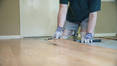 worker removing laminate flooring Footage