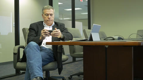 businessman texting in a corporate conference room Footage