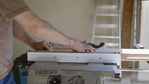 construction worker cutting boards for the stair renovation Footage
