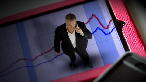tiny businessman standing on a tablet pc with graph Live Action