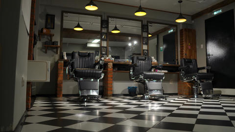 Vintage hanging lamps in hairdressing salon. Ceiling retro lamp in barber shop Footage
