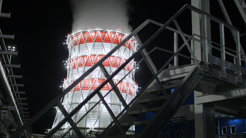 heat power station cooling tower against dark morning sky Footage