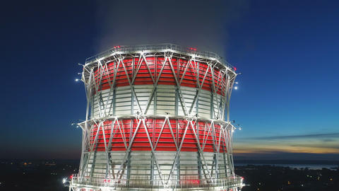 aerial view heating station cooling tower against dark sky Footage