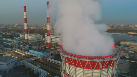 motion above cooling tower with steam at heating station ビデオ