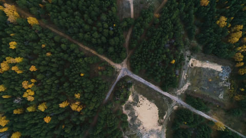 camera rotates over crossroad in wood and construction sites Footage