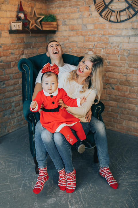 Happy Family with a small daughter celebrating a New Year or Christmas day Fotografía
