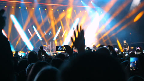 Spectators filmed the artist on the phone during a performance on stage Footage