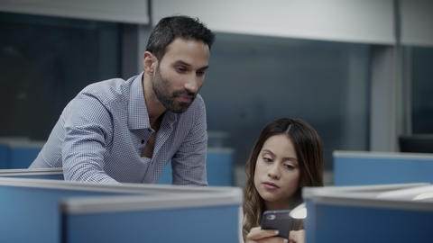 Team Of Young Colleagues Using Phone For Job In Office Footage
