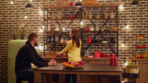 Positive couple spending leisure in the kitchen Footage