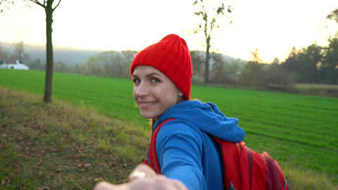 Follow me - happy young woman in red hat pulling guy's... Stock Video Footage