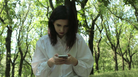 Girl is in the chat, writes and reading comments to the new post on mobile phone ビデオ