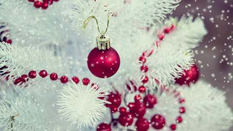 Christmas tree toys decorations and snow-covered Christmas tree branches Footage
