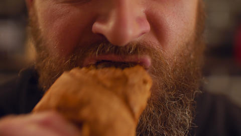 Portrait of bearded man eating croissant Footage