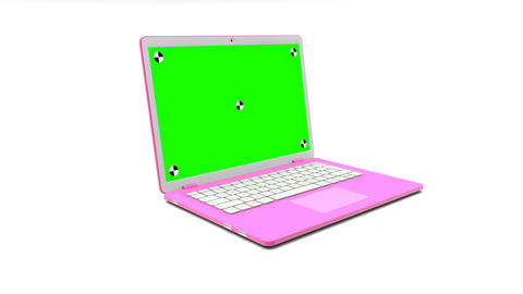 Modern pink laptop with a blank green screen appearing on a white background ビデオ