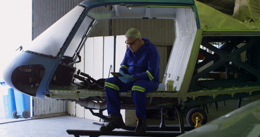 Engineer using digital tablet in aircraft hangar 4k Live Action