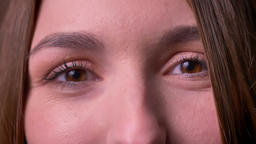 Closeup portrait of woman eyes who opens eyes and watchies directly into camera Footage