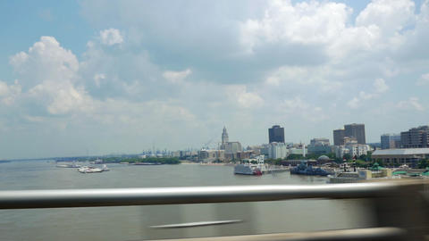 Downtown Baton Rouge LA view from bridge crossing Mississippi river Footage