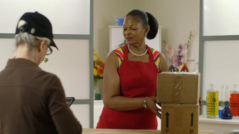 small business owner receives packages Footage