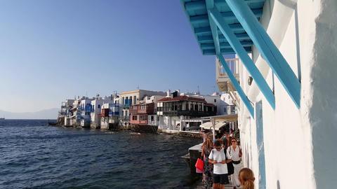 Mykonos, Greece - People walking the narrow path at Little Venice Footage