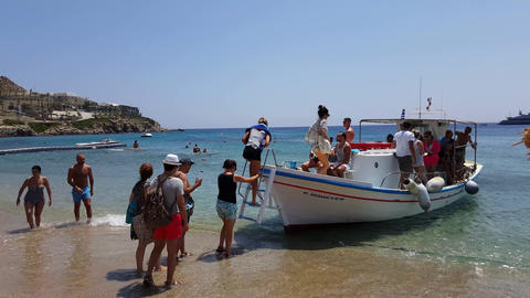 Mykonos, Greece - Tourists embarking water taxi at Paradise beach Footage