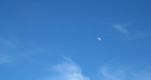 Moon Visible In Daylight Blue Sky With White Soft Clouds Footage