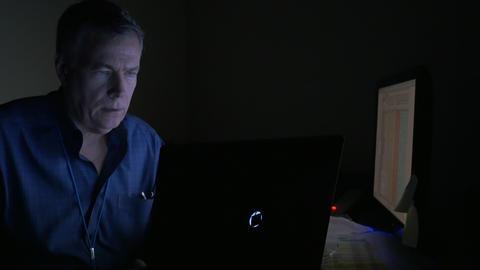 businessman working at night using his laptop 4k Footage