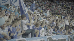 A group of people - football fans at the stadium Footage