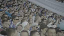 A group of people - football fans at the stadium watching the match Footage