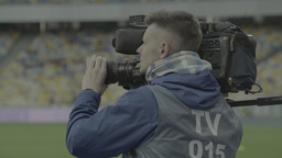 The cameraman shoots at the stadium on camera (close-up) Footage